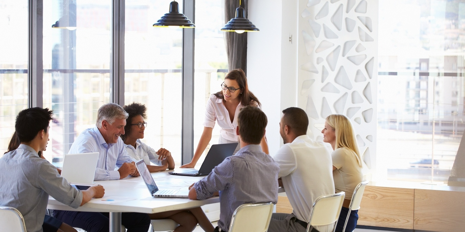 bigstock-Businesswoman-presenting-to-co-90005582-045180-edited.jpg